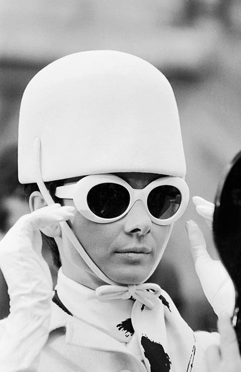 Film actress Audrey Hepburn in a white hat and sunglasses for her role in William Wyler's 1966 comedy caper 'How to Steal a Million', in Paris.