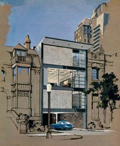 Un edificio de fachada de vidrio que, iluminado con un par de focos exteriores, hacía totalmente visible su interior.